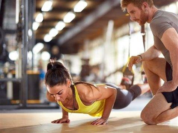 Women and trainer working out